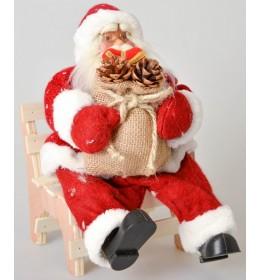 Crveni deda Mraz na stolici 30 cm