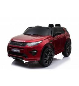 Auto na akumulato Land Rover Discovery sa kožnim sedištem i mekim gumama Crveni