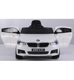 Dečiji auto na akumulator BMW 6 GT LICENCIRANI sa kožnim sedištem i mekim gumama